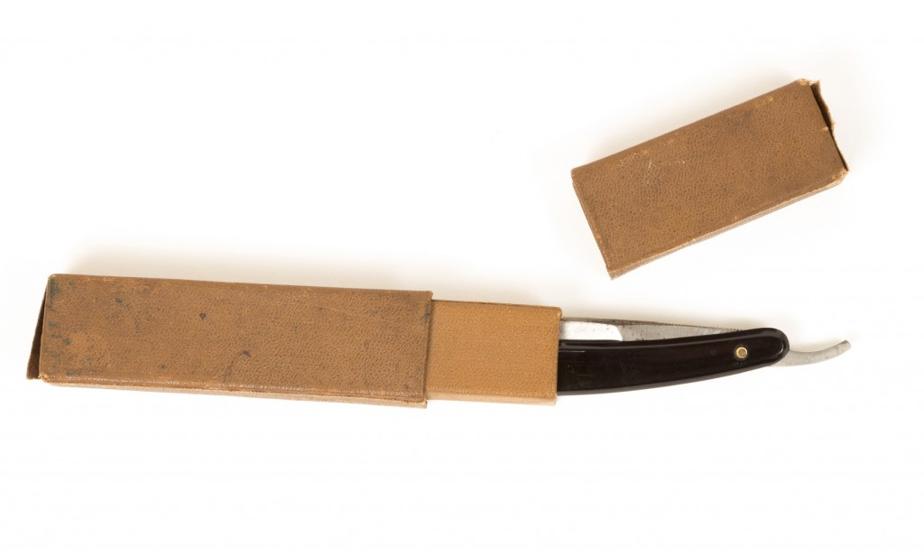 Disposable Straight Razor in cardboard packaging