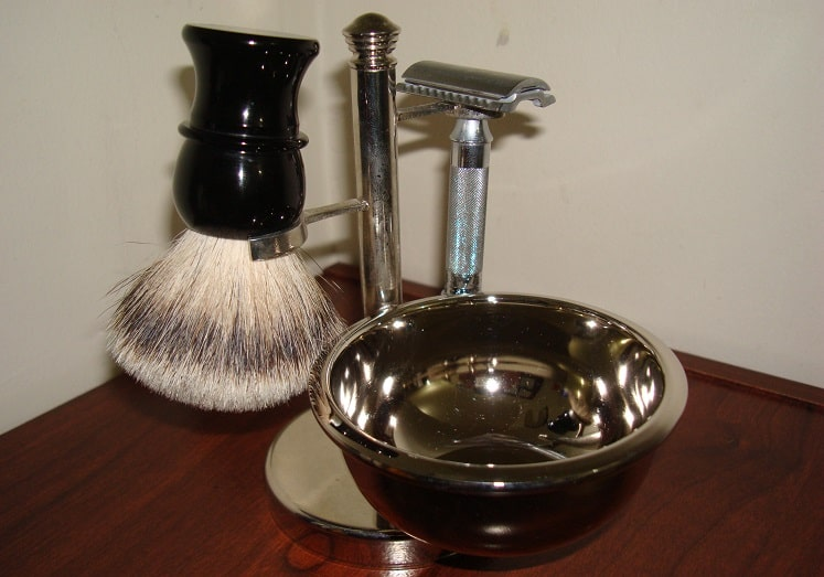 a metallic shaving kit holder