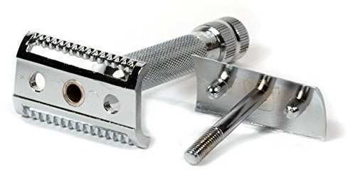 a Merkur slant razor on a table