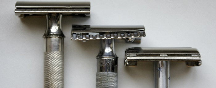 three different-sized butterfly safety razors