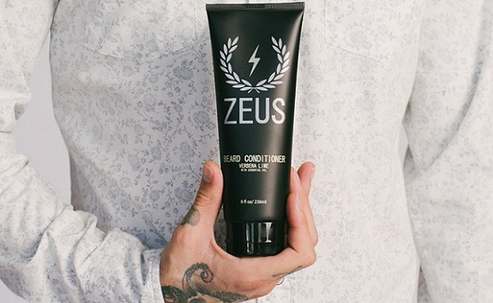 a black bottle of Zeus Beard Conditioner