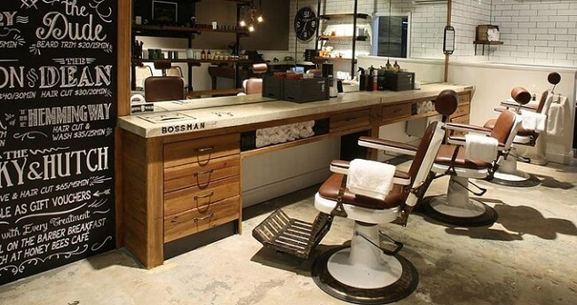the inside of a fancy barber shop