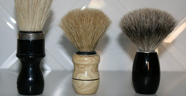 three shaving brushes with different sizes and styles