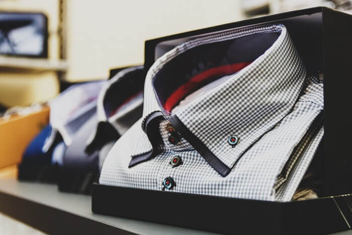 men fashion store with luxury white shirts in boxes