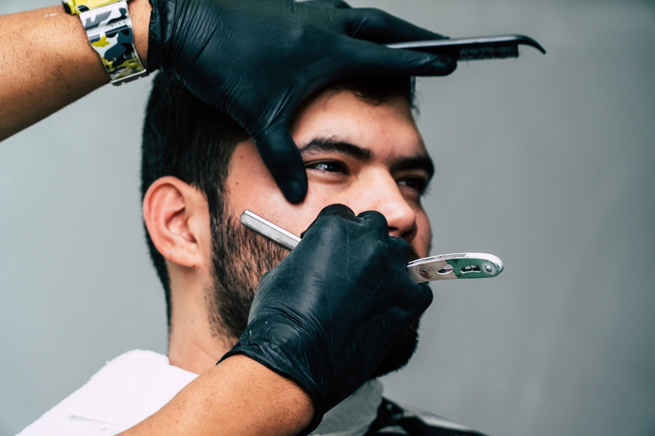 Man using shaving oil