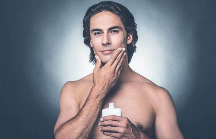 man applying aftershave