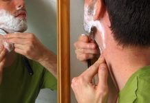 man using a straight razor