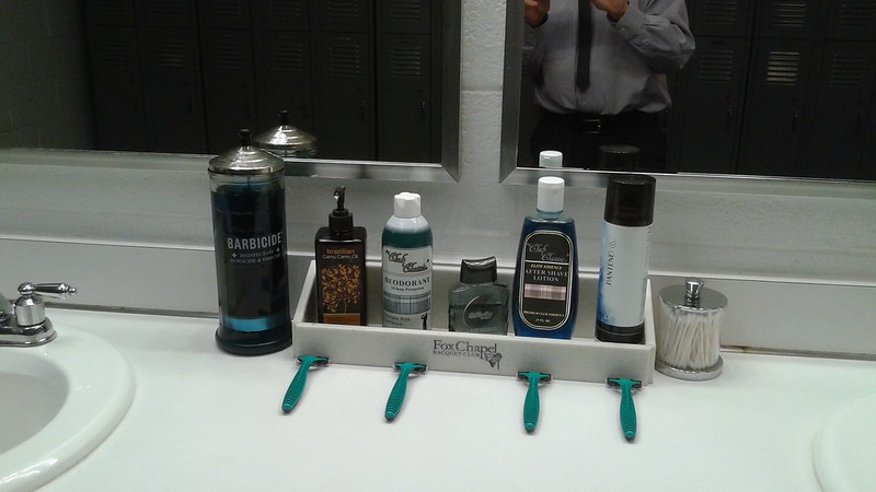 razor barbicide and other cleaner in mens toilet